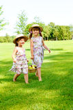 Kids carrying  basket with fruit. Two sweet kids carrying  basket with fruit Stock Photography