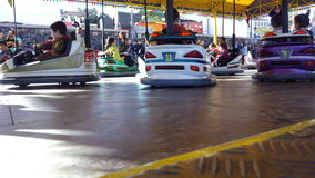 Kids cars in attraction park. Playground carousel Stock Photos