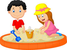 Kids cartoon playing on the beach building a sand castle decoration Stock Photo