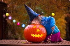 Kids carving pumpkin at Halloween royalty free stock images