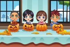 Kids Carving Pumpkin Royalty Free Stock Image