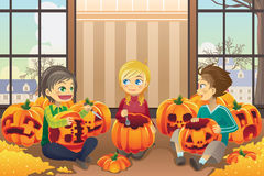 Kids carving pumpkins Royalty Free Stock Image