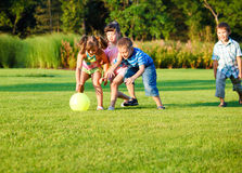 Kids catching the ball Stock Photo
