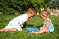 Kids catching butterflies on natural background Stock Photography