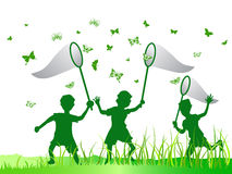 Kids catching butterfly. In green color Stock Photo