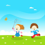 Kids Catching Butterfly. Royalty Free Stock Photography