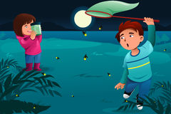 Kids catching fireflies. A vector illustration of happy kids catching fireflies and put them in a jar Stock Image