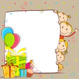 Kids Celebrating Birthday. Illustration of kids peeping behind birthday card with gift and balloon Stock Photography