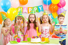 Kids celebrating birthday party Stock Photos
