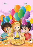 Kids celebrating a birthday with a pizza, burger and fries Royalty Free Stock Images