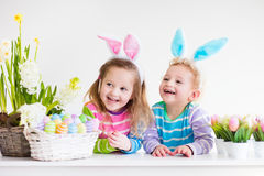 Kids celebrating Easter at home Royalty Free Stock Photos