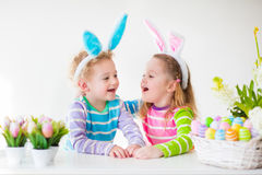 Kids celebrating Easter at home Stock Image
