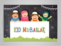 Kids celebrating Eid Mubarak. Stock Photo