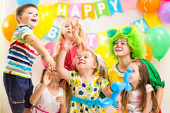 Kids celebrating  merrily birthday party Royalty Free Stock Image