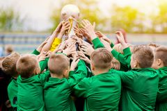 Kids Celebrating Soccer Victory. Young Football Players Holding Trophy. Boys Celebrating Sports Championship. Winning Team of Sport Tournament for Kids royalty free stock photo