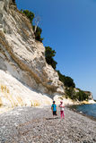 Kids at chalk cliffs. The popular Danish tourist attraction Stevns Klint on a sunny summer day Royalty Free Stock Photo
