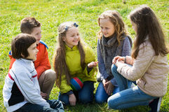 Kids chatting outdoor Royalty Free Stock Photo