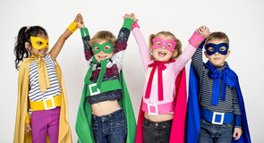 Kids Cheerful Super Heroes Costume Concept. Kids Cheerful Super Heroes Costume stock photo