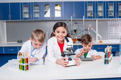 Kids in chemical laboratory Stock Photography
