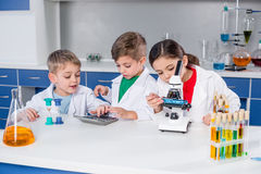 Kids in chemical laboratory Stock Images