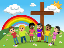 Kids or children hand in hand near christian cross meadow Stock Images