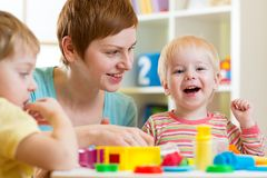 Kids or children and mother play colorful clay toy Stock Photo