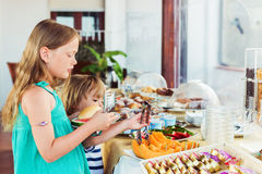 Kids choosing breakfast in restaurant. Kids choosing breakfast in the the restaurant Royalty Free Stock Photo