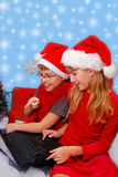 Kids choosing christmas gifts in internet Royalty Free Stock Photos