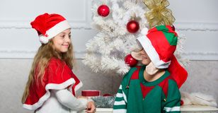 Kids christmas costumes santa and elf. Winter masquerade concept. Merry christmas. Family holiday tradition. Children. Cheerful celebrate christmas. Siblings royalty free stock photos