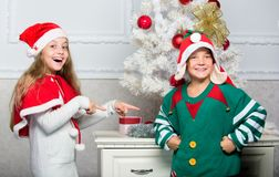 Kids christmas costumes santa and elf. Winter masquerade concept. Siblings ready celebrate christmas or meet new year. Merry christmas. Family holiday stock photography