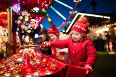 Kids at Christmas fair. Children shopping xmas gifts. Royalty Free Stock Photography