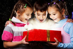 Kids with Christmas gift royalty free stock image