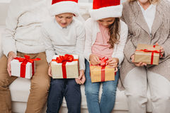 Kids with christmas gifts and grandparents Royalty Free Stock Photos
