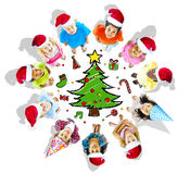 Kids with christmas hats and tree Royalty Free Stock Images