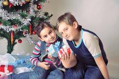 Kids and Christmas present Stock Photos