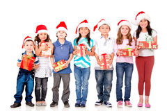 Kids with Christmas presents Stock Images