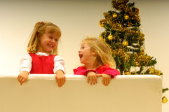 Kids by Christmas Tree Royalty Free Stock Photos