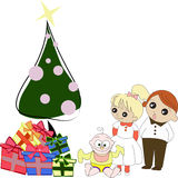 Kids with Christmas tree and gift boxes Stock Photo