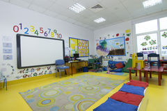 Kids Classroom. With board, chairs and tables Royalty Free Stock Photos