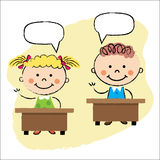 Kids in classroom, sitting at the desks Stock Image