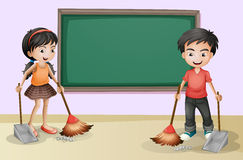 Kids Cleaning Near The Empty Board Royalty Free Stock Photography