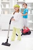 Kids cleaning the room Stock Photo