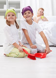 Kids cleaning the room helping their mother Royalty Free Stock Photo