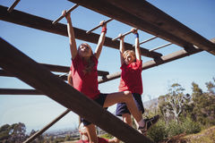 Kids climbing monkey bars during obstacle course training Royalty Free Stock Image