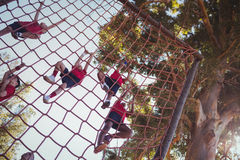Kids climbing a net during obstacle course training Royalty Free Stock Images