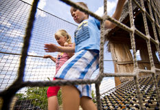 Kids climbing on rope ladder Royalty Free Stock Photos