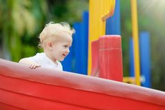 Kids on playground. Children play in summer park. Stock Photography
