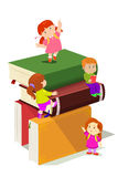 Kids climbing in stack of books Royalty Free Stock Images