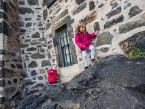 Kids climbing to the castle Stock Photo