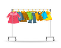 Kids clothes hanging on hanger rack. Kids clothes on hanger rack. Flat style vector illustration. Casual little kids apparel hanging on shop rolling display royalty free illustration